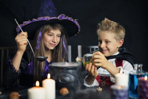Witch and vampire brewing potions