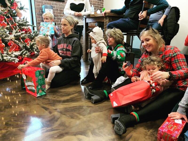 Children open presents from Santa